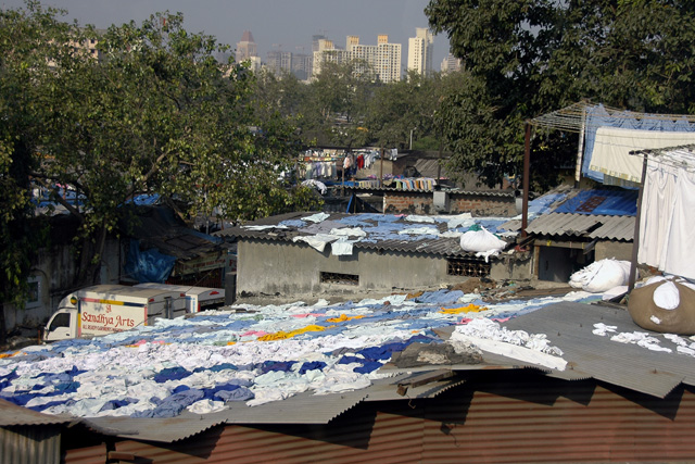 Laundry service, being dried on slum roofs