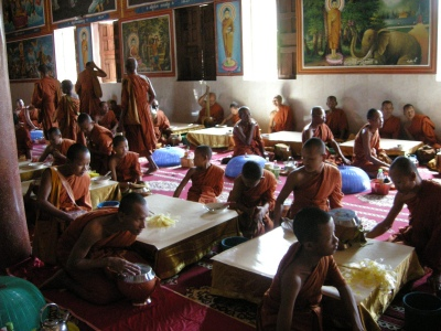 Male monks eating their rice!